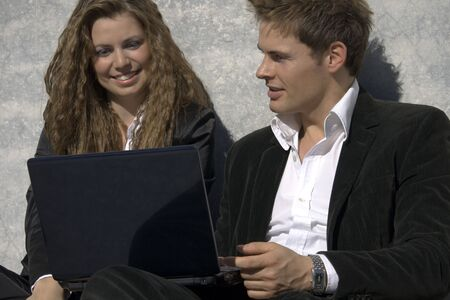 Closeup Portrait Of Successful Man And Woman With Laptop