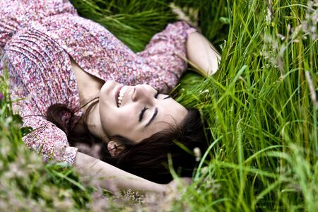 Photo Of A Cute Girl Lying On Grass Field Stock Photo - 5265462