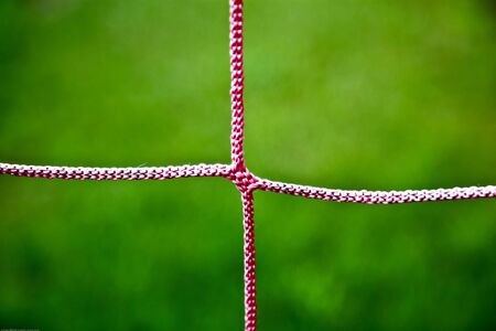 Closeup Photo Of A Red Soccer Net String photo