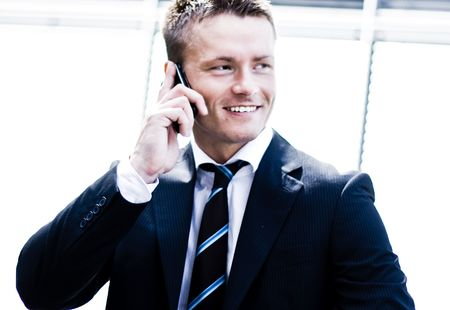 Photo Of A Corporate Man Talking On Mobile Phone