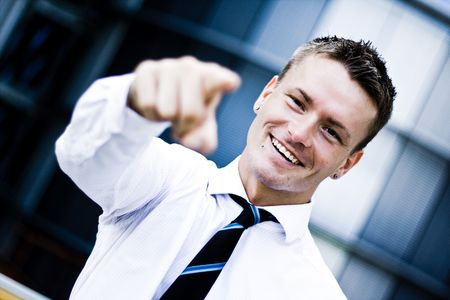 Photo Of A Man In A Corporate Attire Pointing At You Stock Photo