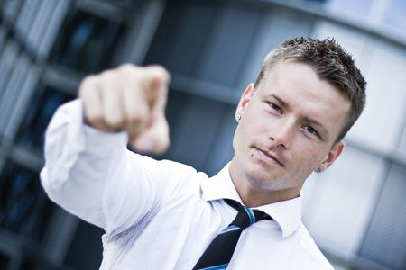 Photo Of A Handsome Corporate Man Pointing At You Stock Photo