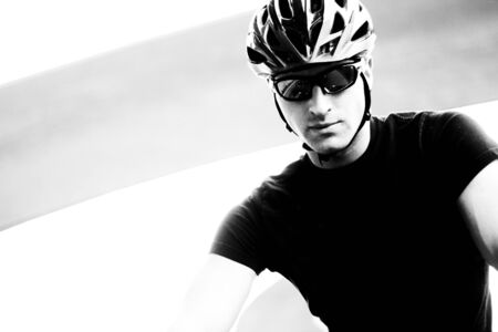 Monotone Closeup Photo Of A Serious Young Cyclist Stock Photo