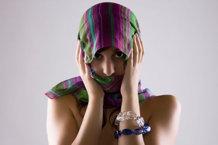Sensual Cute Woman Covering Her Face With A Colorful Veil