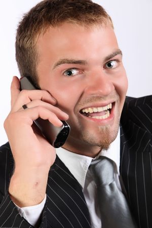 Portrait Of A Corporate Young Man Being Enthusiastic On Telephone
