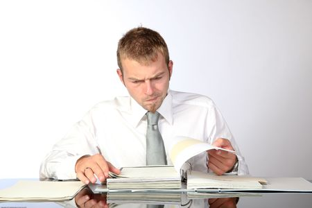 preoccupied: Young Corporate Man Being Preoccupied While Reviewing Some Documents