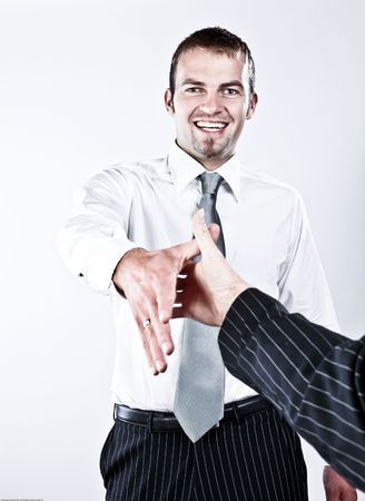 Young Respectful Corporate Man Shaking Hands For A Good Deal Stock Photo