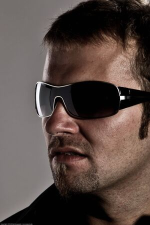 Portrait Of A Handsome Macho Man Wearing Sunglasses