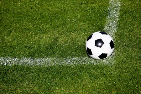 Soccer Ball On The Corner Of The Square Of A Fresh Grassy Field Stock Photo - 5464657