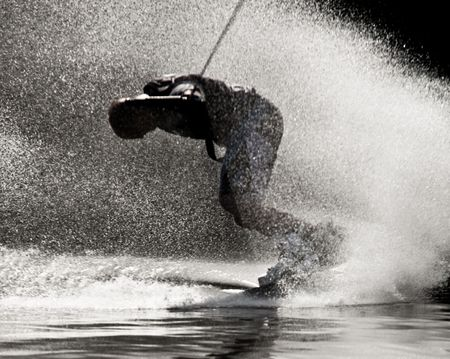 Dymamic Phot Of A Person Drifting On Waterboard And Creating A Steamy Trail