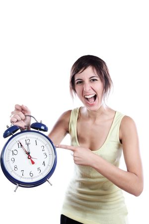 Expressive Young Woman Holding A Big Alarm Clock And Pointing The Time Stock Photo