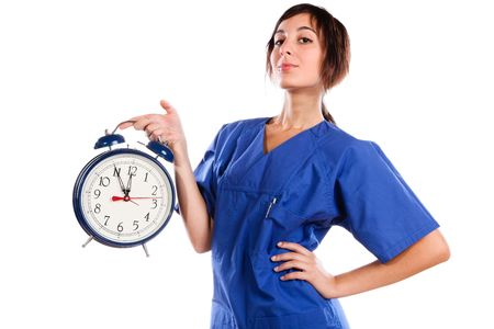 Young Beautiful Woman Holding A Big Alarm Clock Stock Photo - 5768824