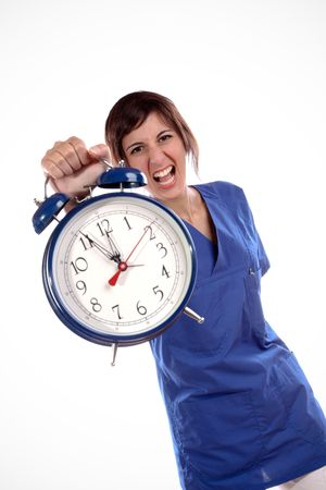 Young Expressive Woman In Blue Uniform Shirt Holding A Big Alarm Clock Stock Photo - 5768825