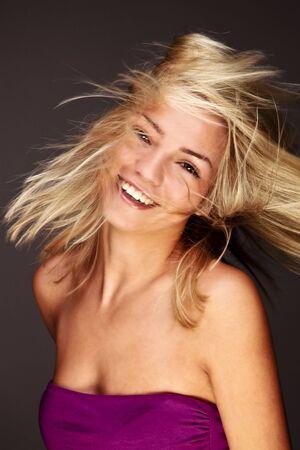 Beautiful Stylish Blond Woman Fluttering Her Golden Hair