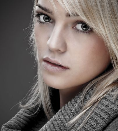 Closeup Of A Sweet Blond Girl With A Big Warm Collar Around Her Neck Stock Photo - 5815169
