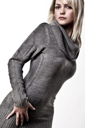 Beautiful Blond Girl Posing In A Big Collar-Herbst-Sweater Standard-Bild
