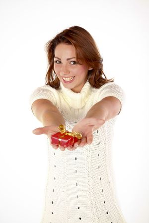 Portrait Of A Beautiful Cheerful Woman Giving A Present