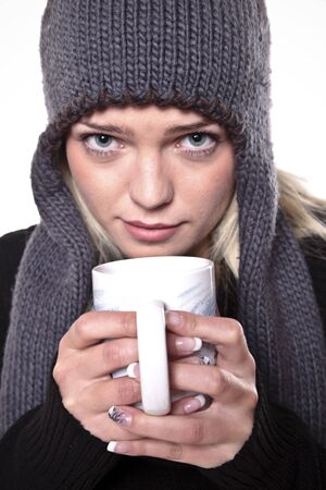 Cute Blond Girl Holding A Hot Drink In The Winter Cold