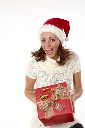 Beautiful Girl With Santa Hat Being Happy With A Present Pack