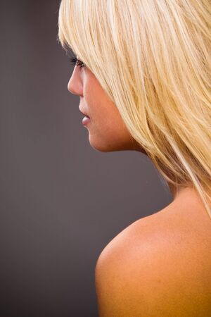 Profile Closeup Portrait Of A Young Beautiful Blond Woman photo