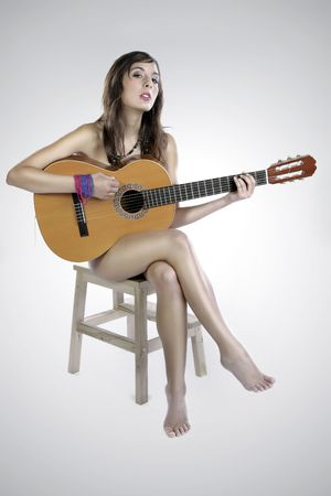 Cute Nude Brunette Girl Playing Guitar On A Chair Stock Photo