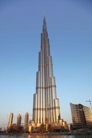 DUBAI, U.A.E. - NOVEMBER 29 : Burj Dubai View With Water Shore And Cranes Around, November 29, 2009 in Dubai, U.A.E