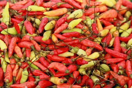 Lots Of Fresh Red And Yellow-green Chili Peppers