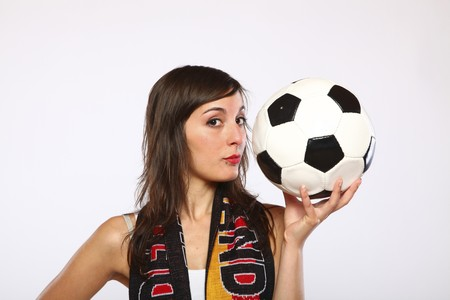 German Soccer Fan Girl Posing With The Ball In Her Hand photo
