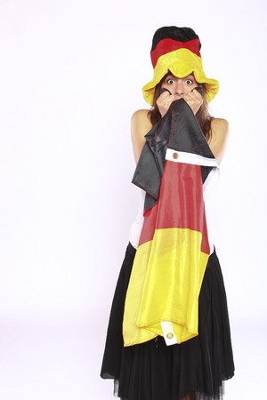 Excited Soccer Fan Girl Wearing The National German Flag And Hat