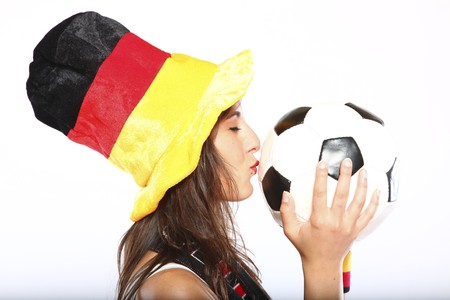 German Soccer Fan Girl With Hat Kissing The Ball