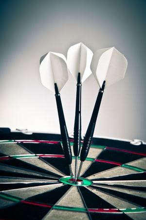 Three Darts Arrows Poked Right In The Center