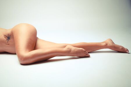 Photo Of White Woman Legs In A Sensual Position Stock Photo