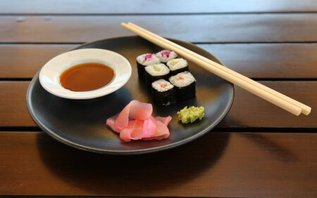 Closeup Of Tasty Japanese Sea Food On A Plate With Fish And Chopsticks Standard-Bild