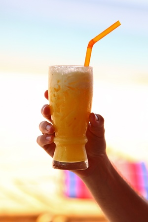 Glass Of Tasty Yellow Refreshment Drink Held On Hand
