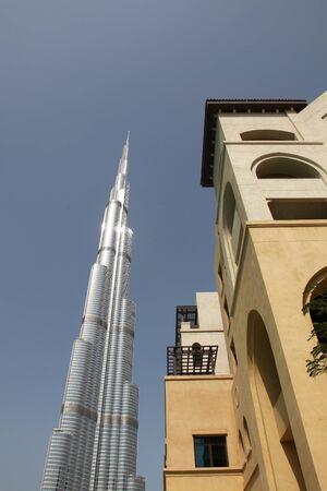 DUBAI, UAE - 2112011: Business Bay Boulevard, Side View Up Of Building Next To Burj Dubai Editorial