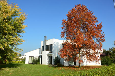 Contemporary modern house in autumn