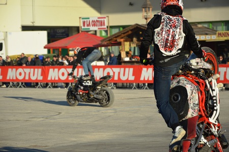 Verona, Italy - jan 20 2017: motor bike expo, stunt man show wheelup