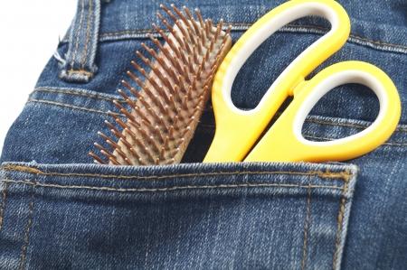 hair cut tool in jean s pocket                               photo