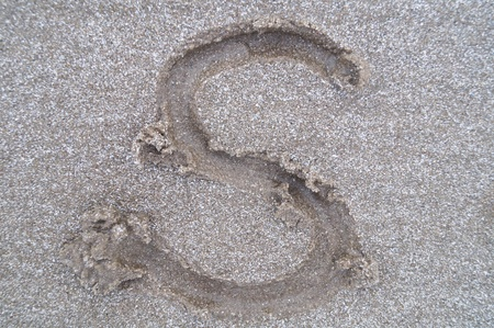 S letter on beach         photo