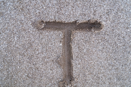 T letter on beach         photo