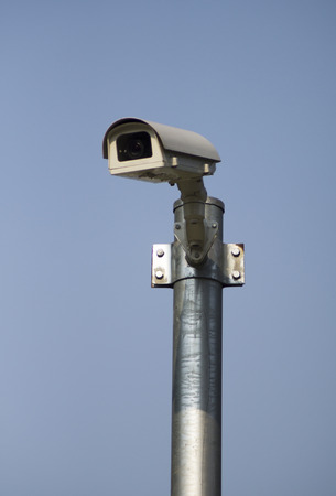 surveillance camera  and CCTV on blue background photo