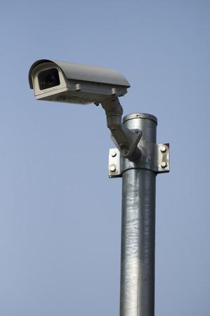 surveillance camera  and CCTV on blue background photo