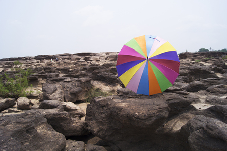umbrela: colorful umbrella on rock with blue sky,Sampanbok of Maekong river, Thailand