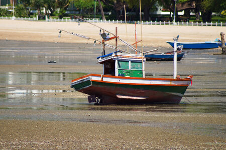waterscape: boat on dry water and beach  Stock Photo
