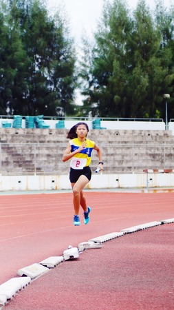 Athletic  running on track Editoriali