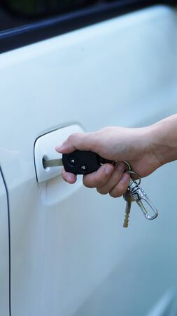 hand holding keying to open car photo