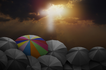 umbrela: colorful umbrella on rock with blue sky,