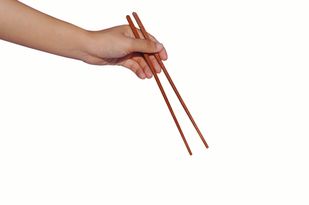 left hand hold  wooden chopsticks of Chinese culture  isolated on white background
