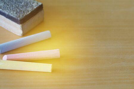 chalk eraser: chalk and eraser on table
