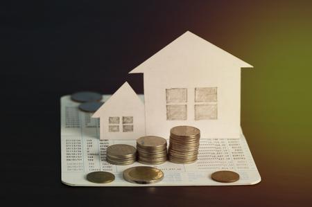 viviendas: money and paper house on dark background Foto de archivo